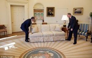 Obama moving a sofa